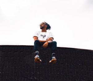 Man sitting on a wall
